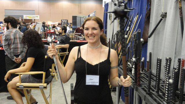 Woman holding medieval mace and hammer