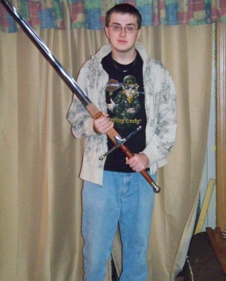 Man with huge medieval sword
