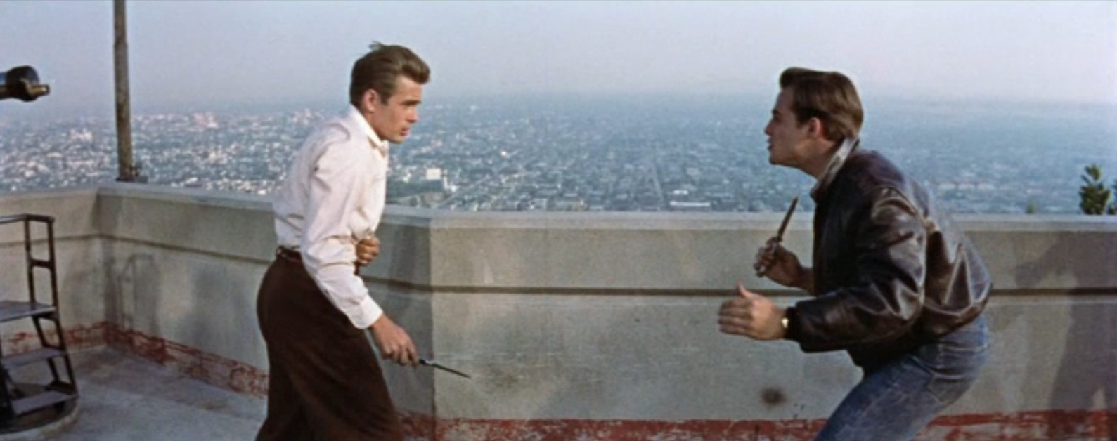 "James Dean wielding a switchblade in ""Rebel Without a Cause."""
